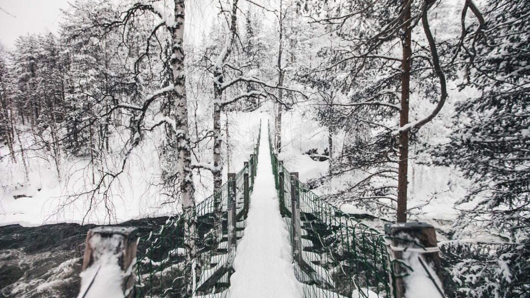 Bridge across Myllykoski rapids at Oulanka National Park Kuusamo Finland.